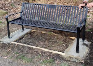 Although the memorial plaque is not pictured on this bench because it was just installed, the top-center location for the plaque is visible.